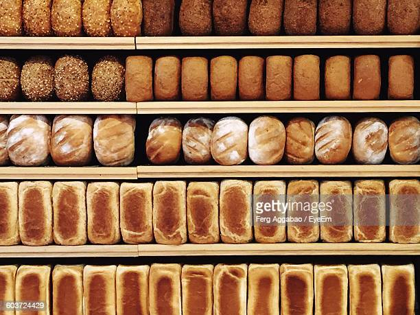 full frame shot of breads in shelf for sale at shop - bread stock pictures, royalty-free photos & images
