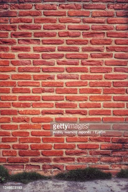 full frame shot of brick wall of building - japonês stock pictures, royalty-free photos & images