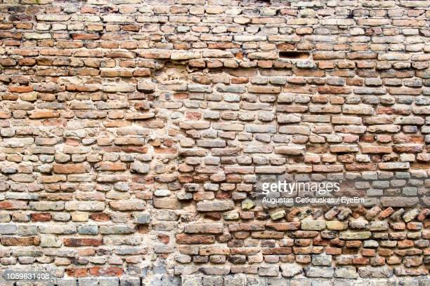 full frame shot of brick wall - cetkauskas stock pictures, royalty-free photos & images
