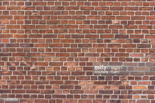 full frame shot of brick wall - brick stock pictures, royalty-free photos & images