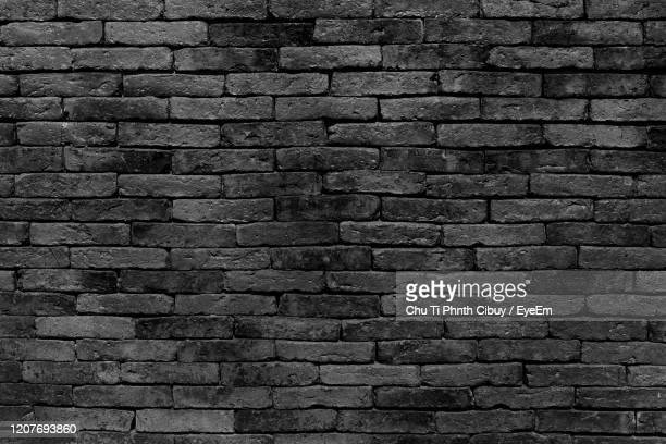 full frame shot of brick wall - stone wall stock pictures, royalty-free photos & images