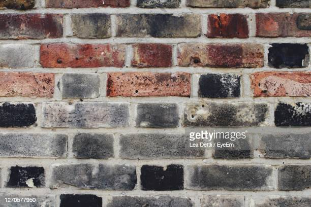 full frame shot of brick wall - physical structure stock pictures, royalty-free photos & images