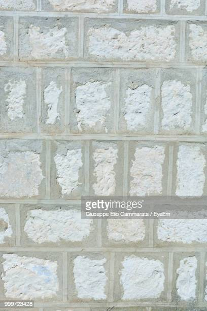 full frame shot of brick wall - cammarata stock photos and pictures