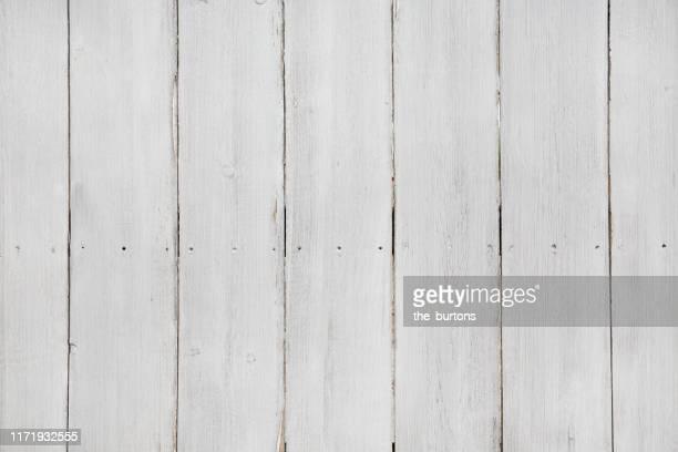 full frame shot of bright painted, weathered wooden wall - leuchtkraft stock-fotos und bilder