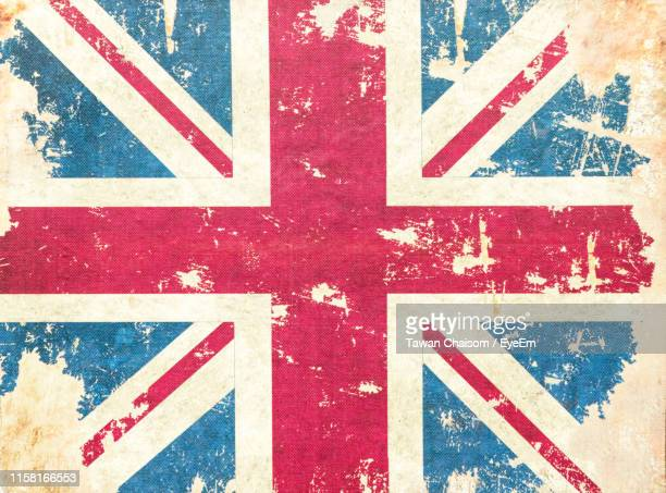 full frame shot of british flag on weathered wall - union jack stock pictures, royalty-free photos & images
