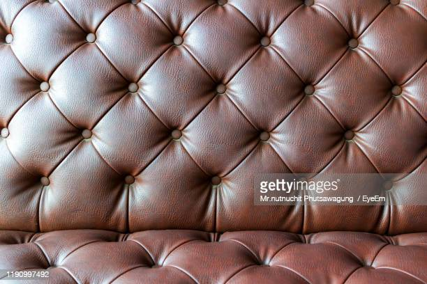 full frame shot of brown sofa - leather stock pictures, royalty-free photos & images