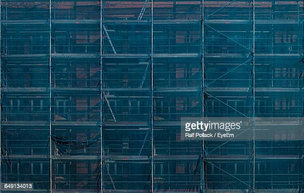 Full Frame Shot Of Building And Scaffolding Covered In Canvas