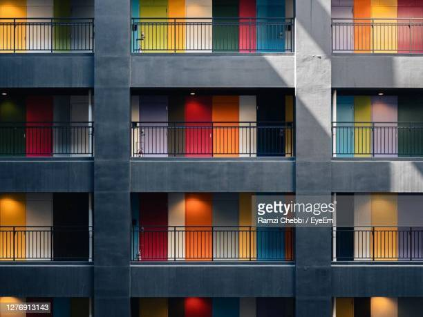 full frame shot of building with windows - tokyo japan stock pictures, royalty-free photos & images