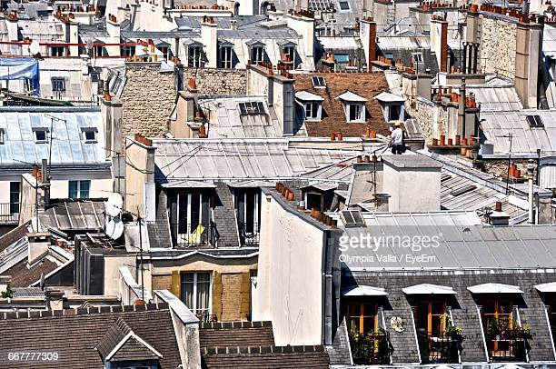 full frame shot of buildings in city - olympia paris stock photos and pictures