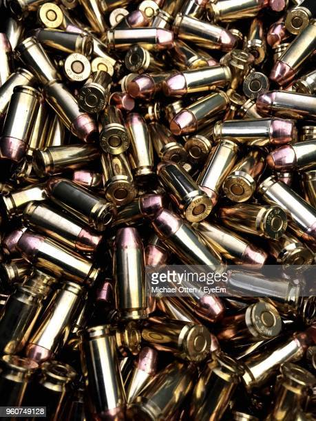 full frame shot of bullets - bullet stock photos and pictures
