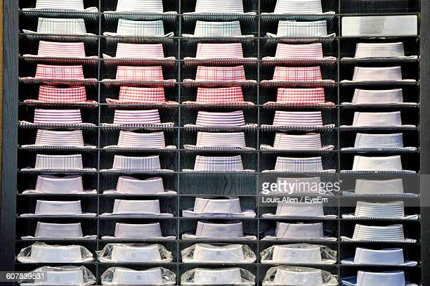 full frame shot of button down shirts in shelf at store - men fashion stock photos and pictures