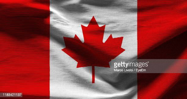 full frame shot of canadian flag - canadian flag stock pictures, royalty-free photos & images