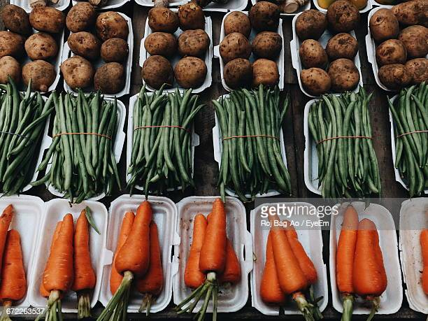 Full Frame Shot Of Carrots, Potatoes, And Green Beans For Sale