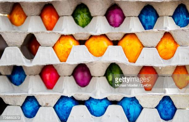 Full Frame Shot Of Cartons With Colorful Easter Eggs