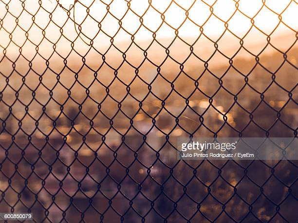 Full Frame Shot Of Chainlink Fence Against City