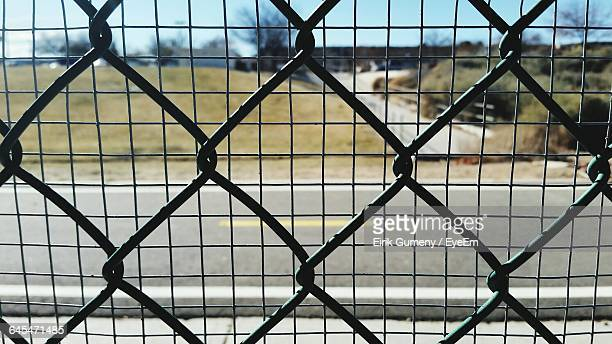 Full Frame Shot Of Chainlink Fence And Metal Grate
