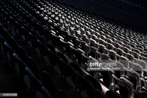 full frame shot of chairs in auditorium - desaparecidos imagens e fotografias de stock