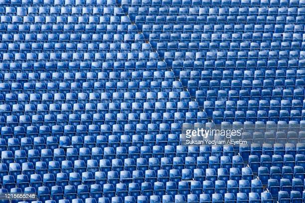 full frame shot of chairs in stadium - stadium stock pictures, royalty-free photos & images