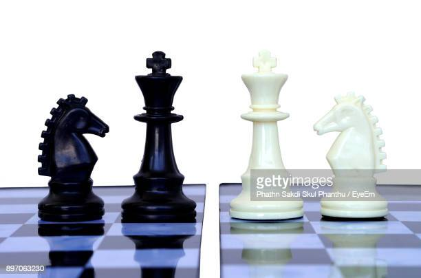 Full Frame Shot Of Chess Pieces Against White Background