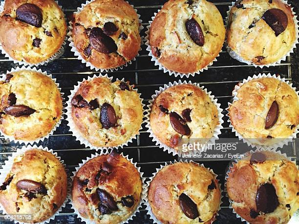 Full Frame Shot Of Chocolate Chip Muffins On Rack