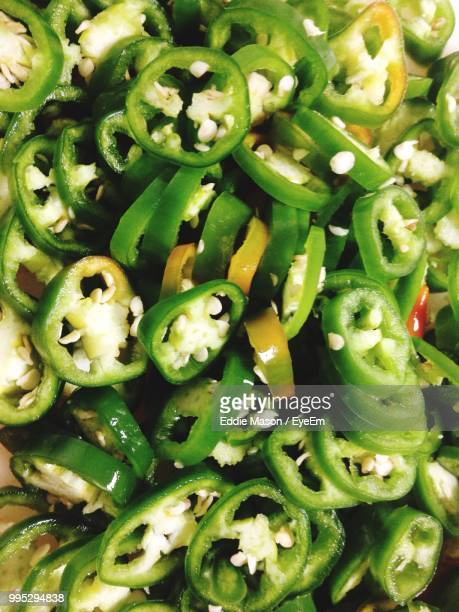 full frame shot of chopped green chili peppers - green chili pepper stock pictures, royalty-free photos & images