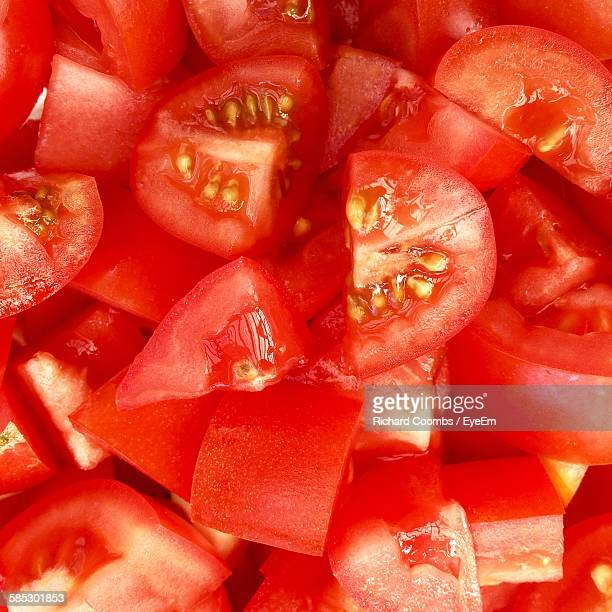 full frame shot of chopped tomatoes - pared stock photos and pictures