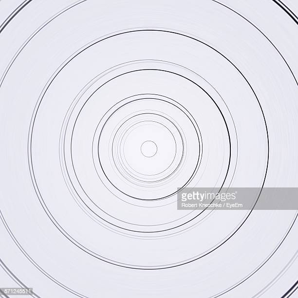 full frame shot of circle shape against white background - concentric stock pictures, royalty-free photos & images