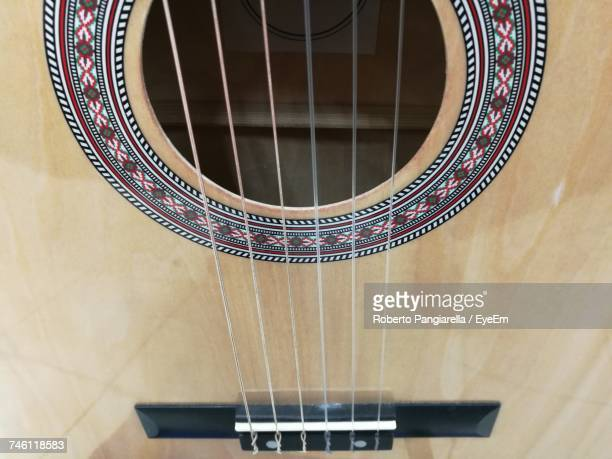 full frame shot of classical guitar - classical guitar stock photos and pictures