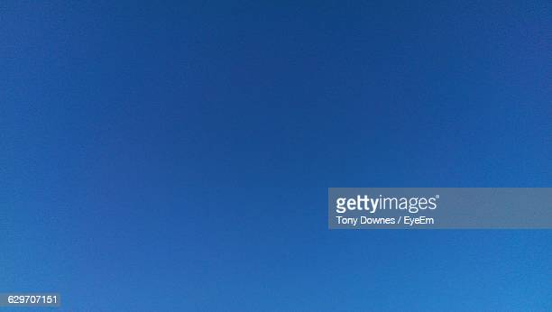 full frame shot of clear blue sky - clear sky stock pictures, royalty-free photos & images