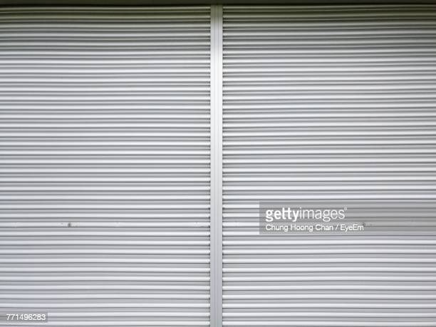 full frame shot of closed shutter - corrugated iron stock photos and pictures