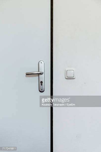 Full Frame Shot Of Closed White Door By Wall