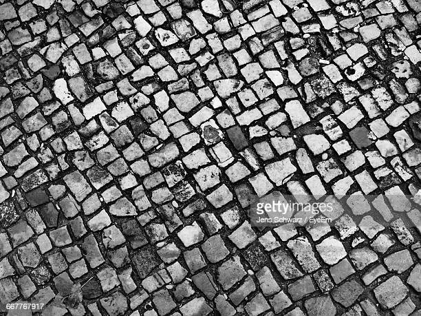 full frame shot of cobblestone footpath - cobblestone stock pictures, royalty-free photos & images
