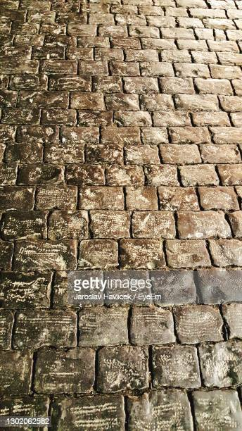 full frame shot of cobblestone on red square in moscow - state kremlin palace stock pictures, royalty-free photos & images