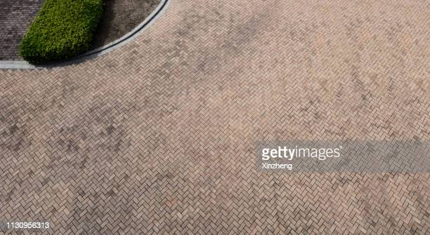 full frame shot of cobblestone paving - paving stone stock pictures, royalty-free photos & images
