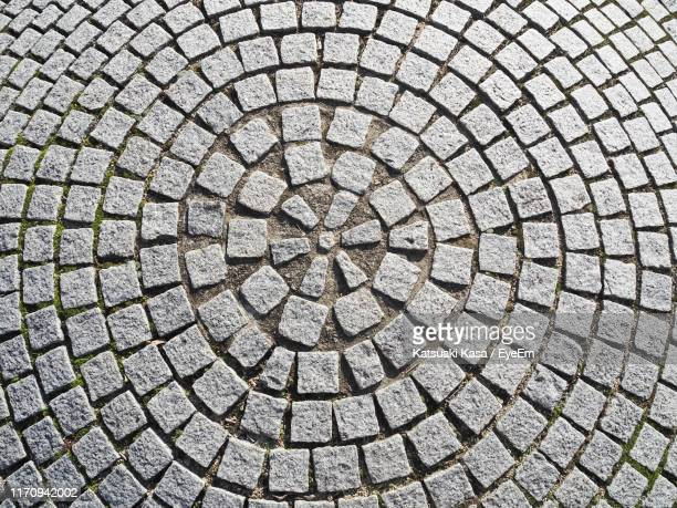 full frame shot of cobblestone street - concentric stock pictures, royalty-free photos & images