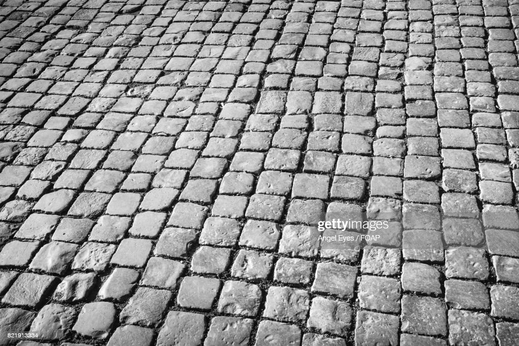 Full frame shot of cobblestone street : Stock Photo