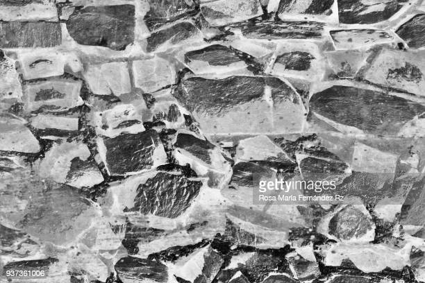 Full frame shot of cobblestone texture. Black and white