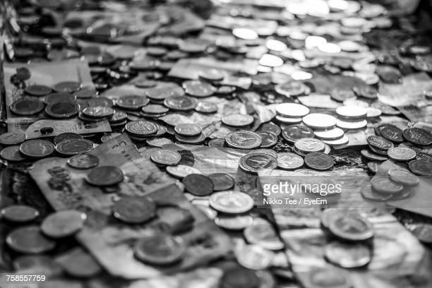 Full Frame Shot Of Coins And Paper Currencies