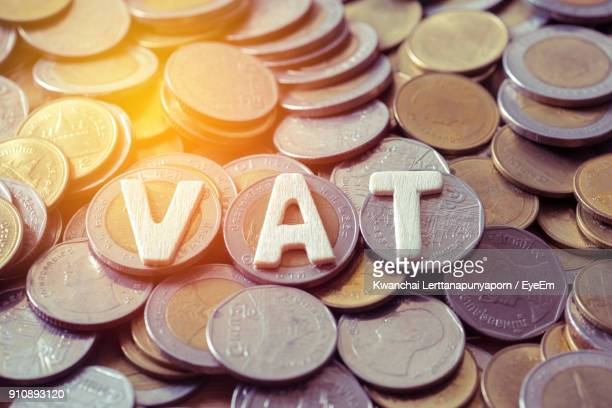 Full Frame Shot Of Coins With Vat Text