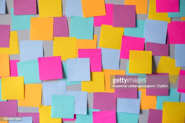 full frame shot of colorful adhesive notes - adhesive note stock pictures, royalty-free photos & images