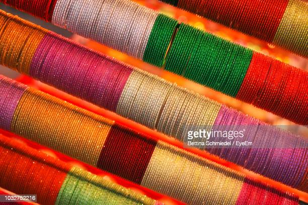 full frame shot of colorful bangles in store - bangle stock pictures, royalty-free photos & images
