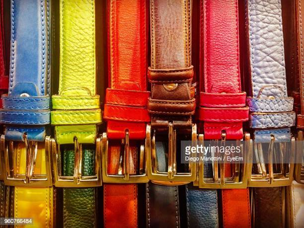 full frame shot of colorful belts hanging for sale - leather belt stock pictures, royalty-free photos & images