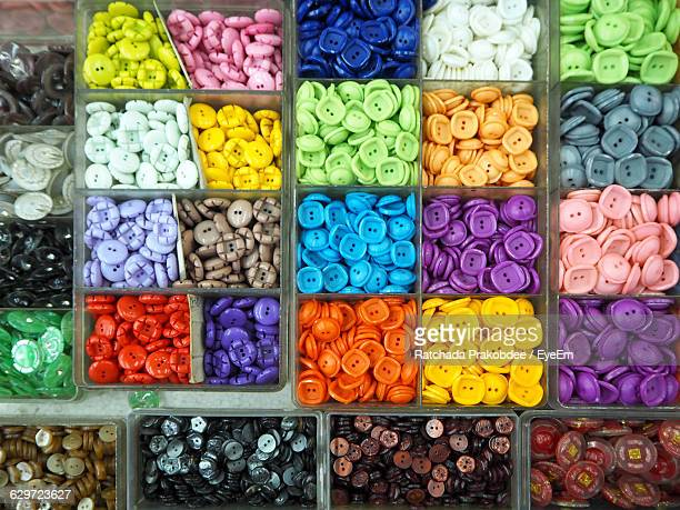 Full Frame Shot Of Colorful Buttons In Containers At Store