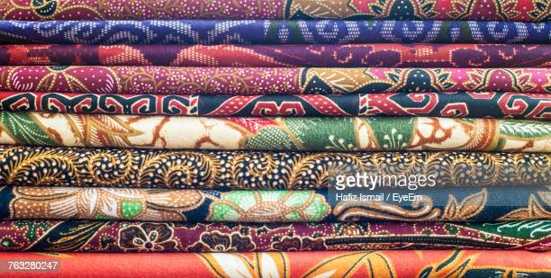 full frame shot of colorful clothing for sale at store - indonesian cloth 個照片及圖片檔