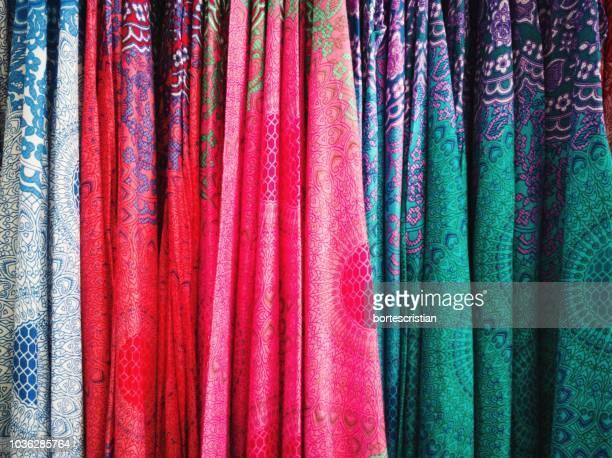 full frame shot of colorful fabrics for sale at store - bortes foto e immagini stock