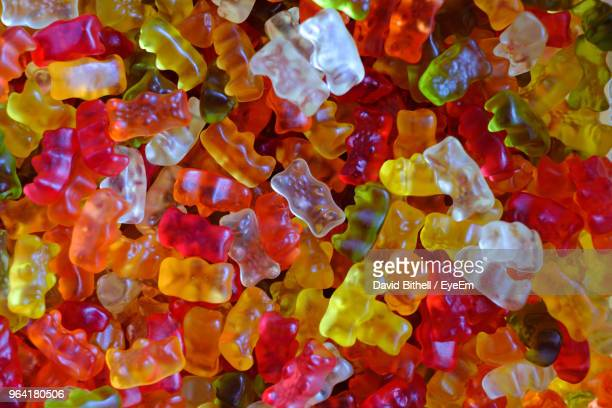 full frame shot of colorful gummi bears - gummi bears stock photos and pictures