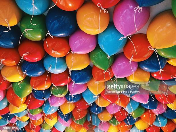full frame shot of colorful helium balloons against ceiling in portaventura - ceiling stock pictures, royalty-free photos & images