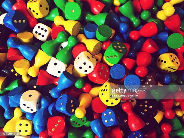 full frame shot of colorful ludo pieces and dice - board game stock pictures, royalty-free photos & images
