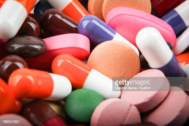 full frame shot of colorful pills - antibiotic stock pictures, royalty-free photos & images