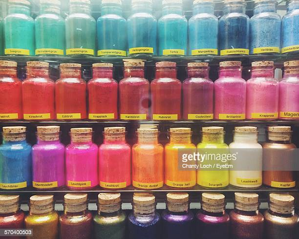 Full Frame Shot Of Colorful Powder Paint Bottles On Display In Store